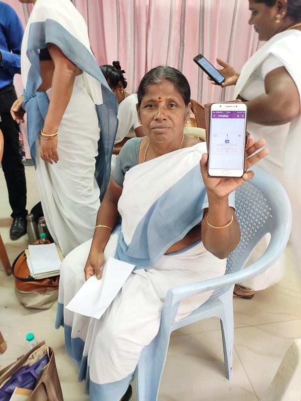 Healthworker showing her E certificate, Kancheepuram, TN